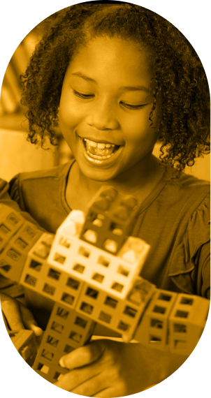 Young student smiling while playing with STEM learning tools